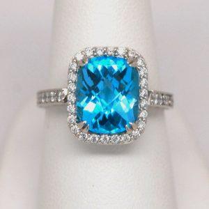 Cushion Shaped Blue Topaz & Round Diamond Halo Ring 14k White Gold