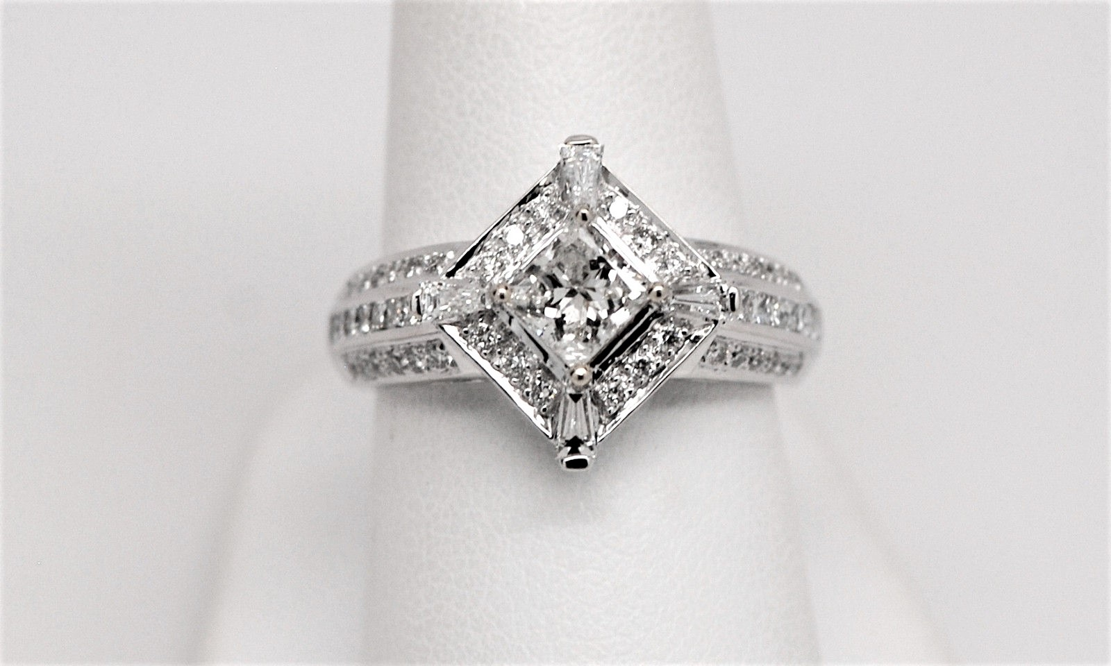 stone tapered in and white side engagement rings diamond heart shape three with baguette ring stones center platinum